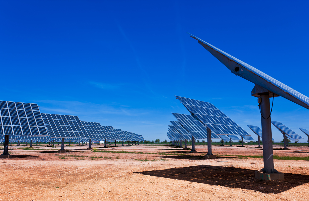 solar pannels in the desert with blue sky