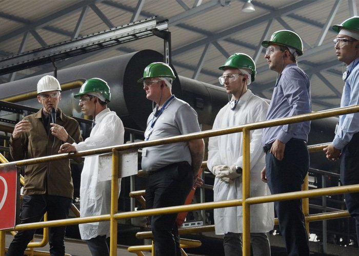 men visiting a factory offshore