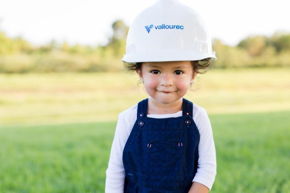 Little girl with Vallourec safety helmet