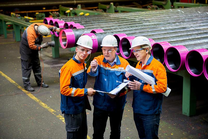 Three men in a Vallourec pipe plant in Rath